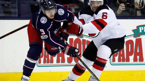 Columbus Blue Jackets forward Artemi Panarin, left, of Russia, tries to pass against New Jersey Devils defenseman Andy Greene during the first period of an NHL hockey game in Columbus, Ohio, Tuesday, Dec. 5, 2017. (AP Photo/Paul Vernon)