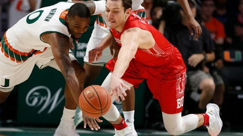 Miami guard Ja'Quan Newton (0) and Boston University forward Nick Havener battle for a loose ball during the first half of an NCAA college basketball game, Tuesday, Dec. 5, 2017, in Coral Gables, Fla. (AP Photo/Wilfredo Lee)