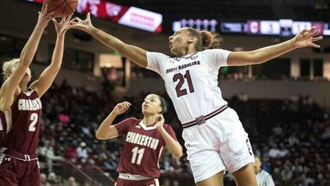 South Carolina forward Mikiah Herbert Harrigan (21) reaches for a rebound against College of Charleston guard Darien Huff (2) during the first half of an NCAA college basketball game Tuesday, Dec. 5, 2017, in Columbia, S.C. (AP Photo/Sean Rayford)