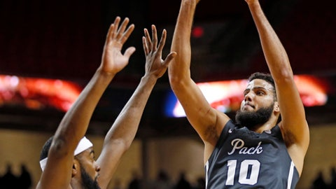 Nevada's Caleb Martin (10) shoot over Texas Tech's Niem Stevenson (10) during the first half of an NCAA college basketball game Tuesday, Dec. 5, 2017, in Lubbock, Texas. (AP Photo/Brad Tollefson)