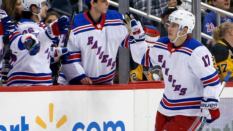 New York Rangers' Jesper Fast (17) returns to the bench after scoring during the second period of an NHL hockey game against the Pittsburgh Penguins in Pittsburgh, Tuesday, Dec. 5, 2017. (AP Photo/Gene J. Puskar)