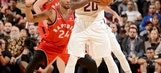 Booker carried off with groin injury in Suns loss to Raptors