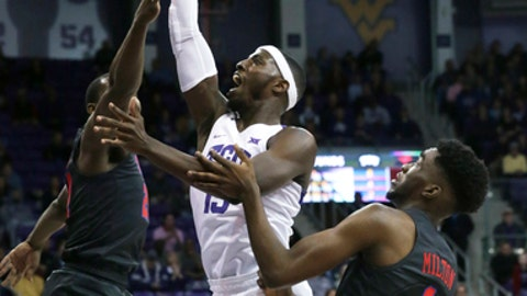 TCU forward JD Miller (15) shoots against SMU defenders Ben Emelogu II (21) and Shake Milton (1) during the first half of an NCAA college basketball game in Fort Worth, Texas, Tuesday, Dec. 5, 2017. (AP Photo/LM Otero)