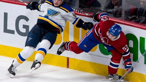 St. Louis Blues' Sammy Blais (64) and Montreal Canadiens' Victor Mete (53) collide against the boards during the third period of an NHL hockey game, Tuesday, Dec. 5, 2017 in Montreal. (Paul Chiasson/The Canadian Press via AP)