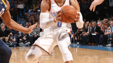 OKLAHOMA CITY, OK - DECEMBER 5:  Russell Westbrook #0 of the Oklahoma City Thunder handles the ball against the Utah Jazz on December 5, 2017 at Chesapeake Energy Arena in Oklahoma City, Oklahoma. NOTE TO USER: User expressly acknowledges and agrees that, by downloading and or using this photograph, User is consenting to the terms and conditions of the Getty Images License Agreement. Mandatory Copyright Notice: Copyright 2017 NBAE (Photo by Layne Murdoch/NBAE via Getty Images)