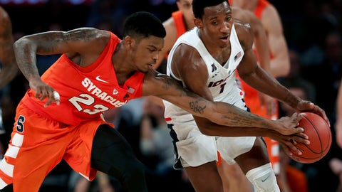 Syracuse guard Frank Howard (23) strips the ball from Connecticut guard Christian Vital (1) during the first half of an NCAA college basketball game, Tuesday, Dec. 5, 2017, in New York. (AP Photo/Julie Jacobson)