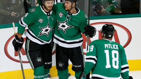 Dallas Stars defenseman Jamie Oleksiak (5), Radek Faksa (12) and Tyler Pitlick (18) celebrate a goal scored by Oleksiak during the third period of an NHL hockey game against the Nashville Predators on Tuesday, Dec. 5, 2017, in Dallas. The Predators won 5-2. (AP Photo/Tony Gutierrez)
