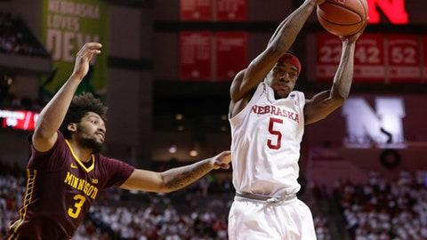 Nebraska's Glynn Watson Jr. (5) gets control of the ball next to Minnesota's Jordan Murphy (3) during the second half of an NCAA college basketball game in Lincoln, Neb., Tuesday, Dec. 5, 2017. Nebraska won 78-68. (AP Photo/Nati Harnik)
