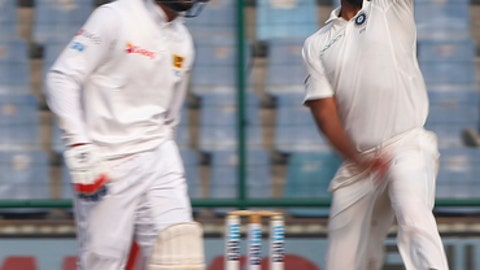 India's Mohammed Shami, right, bowls a delivery during the fifth day of their third test cricket match against Sri Lanka in New Delhi, India, Wednesday, Dec. 6, 2017. (AP Photo/Altaf Qadri)
