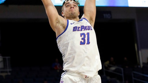 FILE - In this Dec. 2, 2017 file photo, DePaul guard Max Strus goes up for a dunk against Youngstown during an NCAA college basketball game in Chicago. Strus transferred from Division II Lewis University to Division I DePaul, where he is the team's leading scorer this season. Strus is among fewer than 10 transfers who made the move from D2 to D1 this season. (AP Photo/Nam Y. Huh, File)