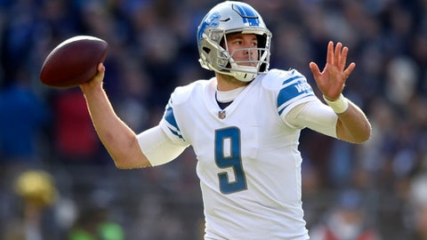 FILE - In this Dec. 3, 2017, file photo, Detroit Lions quarterback Matthew Stafford throws to a receiver in the first half of an NFL football game against the Baltimore Ravens, in Baltimore. Stafford was expected to test three banged-up fingers on his throwing hand in practice in the hopes of playing Sunday at Tampa Bay. Stafford's right hand was stepped on in his last game, a loss at Baltimore that knocked him out of the game and put his team's playoff outlook in peril. (AP Photo/Gail Burton, File)