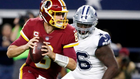 FILE - In this Thursday, Nov. 30, 2017, file photo, Washington Redskins quarterback Kirk Cousins (8) scrambles out of the pocket before throwing a pass under pressure from Dallas Cowboys' Maliek Collins, rear, in the first half of an NFL football game in Arlington, Texas. With the Redskins essentially out of playoff contention, their biggest question moving forward concerns the future of Cousins, who is again set to be a free agent after consecutive seasons on the franchise tag. (AP Photo/Michael Ainsworth, File)