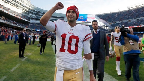 FILE - In this Sunday, Dec. 3, 2017, file photo, San Francisco 49ers quarterback Jimmy Garoppolo (10) celebrates after their 15-14 win over the Chicago Bears in an NFL football game in Chicago. Garoppolo looks to follow up a successful first start for the 49ers with another this week against Houston. (AP Photo/Charles Rex Arbogast, File)