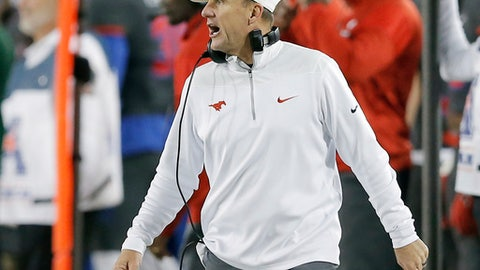 FILE - In this Nov. 19, 2016, file photo, SMU head coach Chad Morris shouts instructions from the sidelines during the first half of an NCAA college football game against  South Florida, in Dallas. A person with direct knowledge of the decision tells The Associated Press that Arkansas has hired SMU's Chad Morris to become the school's new football coach. The person spoke Tuesday night, Dec. 5, 2017, on the condition of anonymity because the decision hasn't been made public yet.(AP Photo/Brandon Wade, File)