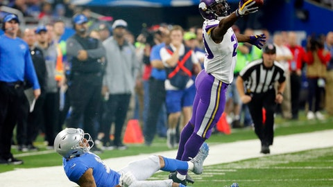 FILE - In this Thursday, Nov. 23, 2017, file photo, Minnesota Vikings cornerback Xavier Rhodes (29) intercepts a pass intended for Detroit Lions wide receiver Marvin Jones during the second half of an NFL football game in Detroit. The Vikings let cornerback Captain Munnerlyn sign with the Carolina Panthers in free agency, but their pass coverage hasn't slipped with Rhodes, Mackensie Alexander, Trae Waynes and Terence Newman helping to hold together a quality group. (AP Photo/Rick Osentoski, File)