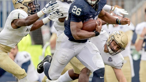 FILE - In this Sept. 2, 2017, file photo, Penn State running back Saquon Barkley runs from a pack of Akron defenders during an NCAA college football game in State College, Pa. Barkley was selected to the AP All-Conference Big Ten team announced Wednesday, Dec. 6, 2017. (Abby Drey/Centre Daily Times via AP, File)