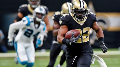 FILE - In this Sunday, Dec. 3, 2017, file photo, New Orleans Saints running back Mark Ingram (22) carries on a 72-yard run in the first half of an NFL football game against the Carolina Panthers in New Orleans, When the first-place New Orleans Saints face the Atlanta Falcons on Thursday night in an NFC South matchup with serious playoff ramifications, the spotlight will be on the guys in the backfield. (AP Photo/Bill Feig,FIle)