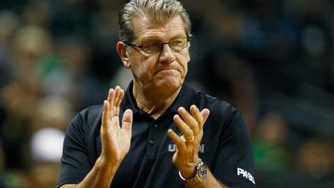 FILE - In this Nov. 25, 2017, file photo, Connecticut head coach Geno Auriemma claps for his players in the first half of an NCAA college basketball game in Eugene, Ore. Coaches, college athletics officials and several agents are supporting an effort to strengthen laws that regulate sports agent conduct. A memo has been sent to officials who work with legislators in each state with the goal of getting the Revised Uniform Athlete Agents Act passed. Auriemma's name appears on the memo. (AP Photo/Timothy J. Gonzalez, File)