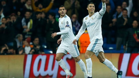 Real Madrid's Cristiano Ronaldo, right, celebrates with team mate Real Madrid's Theo Hernandez after scoring his side's second goal during the Champions League Group H soccer match between Real Madrid and Borussia Dortmund at the Santiago Bernabeu stadium in Madrid, Spain, Wednesday, Dec. 6, 2017. (AP Photo/Francisco Seco)