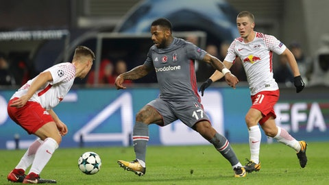 Besiktas' Jeremain Lens, center, goes past Leipzig's Willi Orban, left, and Diego Demme during the Champions League Group G soccer match between RB Leipzig and Besiktas JK in Leipzig, Germany, Wednesday, Dec. 6, 2017. (AP Photo/Michael Sohn)