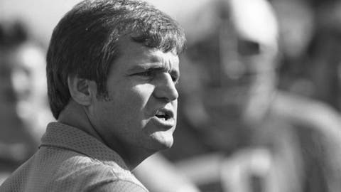 "FILE - In this Dec. 17, 1980, file photo, Ron Meyer, head football coach at Southern Methodist University, shouts instructions to his team as they practice for their confrontation with Brigham Young University in the Holiday Bowl in San Diego. From SMU's ""Pony Express"" to the NFL's infamous ""Snowplow Game,"" former college and professional football coach Ron Meyer was in the middle of some of the game's most controversial and colorful teams and moments in the 1980s. Meyer died Tuesday, Dec. 5, 2017, in Austin, Texas, at age 76. (AP Photo/Lenny Ignelzi, File)"