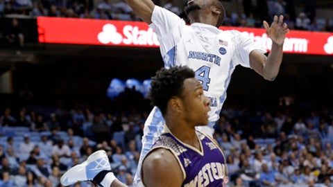 North Carolina's Brandon Robinson (4) drives to the basket while Western Carolina's Desmond Johnson (1) defends during the first half of an NCAA college basketball game in Chapel Hill, N.C., Wednesday, Dec. 6, 2017. (AP Photo/Gerry Broome)