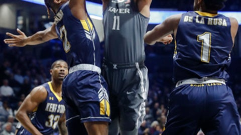 Xavier's Kerem Kanter (11) shoots against Kent State's BJ Duling (2) during the first half of an NCAA college basketball game Wednesday, Dec. 6, 2017, in Cincinnati. (AP Photo/John Minchillo)
