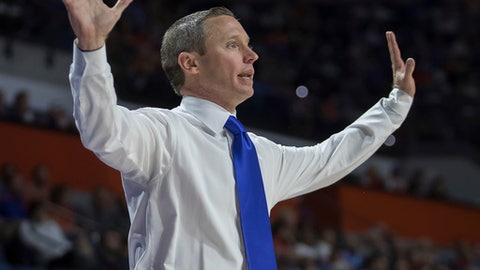 Florida head coach Mike White signals to his team during the first half of an NCAA college basketball game against Loyola of Chicago in Gainesville, Fla., Wednesday, Dec. 6, 2017. (AP Photo/Ron Irby)