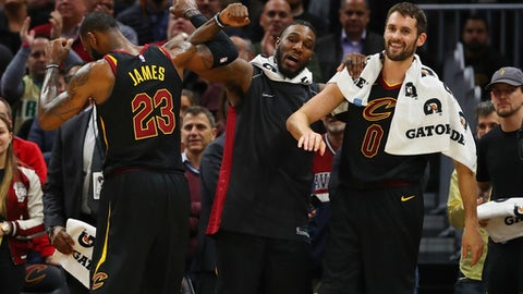 CLEVELAND, OH - DECEMBER 06:  LeBron James #23 of the Cleveland Cavaliers celebrates with Jae Crowder #99 and Kevin Love #0 after leaving the game against the Sacramento Kings at Quicken Loans Arena on December 6, 2017 in Cleveland, Ohio. Cleveland won the game 101-95. NOTE TO USER: User expressly acknowledges and agrees that, by downloading and or using this photograph, User is consenting to the terms and conditions of the Getty Images License Agreement.  (Photo by Gregory Shamus/Getty Images)