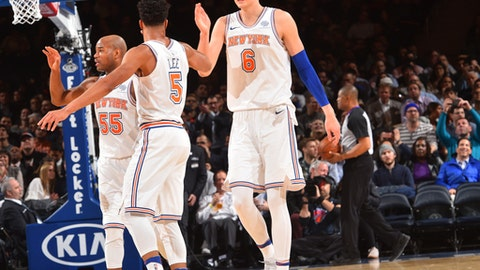NEW YORK,NY - DECEMBER 6 : Kristaps Porzingis #6 Courtney Lee #5 and Jarrett Jack #55 of the New York Knicks share a moment against the Memphis Grizzlies at Madison Square Garden on December 6, 2017 in New York,New York NOTE TO USER: User expressly acknowledges and agrees that, by downloading and/or using this Photograph, user is consenting to the terms and conditions of the Getty Images License Agreement. Mandatory Copyright Notice: Copyright 2017 NBAE (Photo by Jesse D. Garrabrant/NBAE via Getty Images)