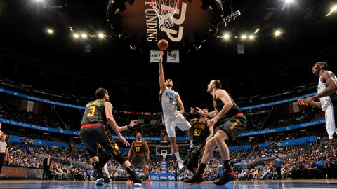 ORLANDO, FL - DECEMBER 6: Evan Fournier #10 of the Orlando Magic shoots the ball against the Atlanta Hawks on December 6, 2017 at Amway Center in Orlando, Florida. NOTE TO USER: User expressly acknowledges and agrees that, by downloading and or using this photograph, User is consenting to the terms and conditions of the Getty Images License Agreement. Mandatory Copyright Notice: Copyright 2017 NBAE (Photo by Fernando Medina/NBAE via Getty Images)