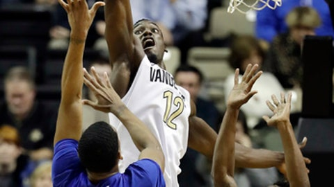 Vanderbilt center Djery Baptiste (12) blocks a shot by Middle Tennessee forward Nick King (5) in the second half of an NCAA college basketball game Wednesday, Dec. 6, 2017, in Nashville, Tenn. Middle Tennessee won 66-63. (AP Photo/Mark Humphrey)