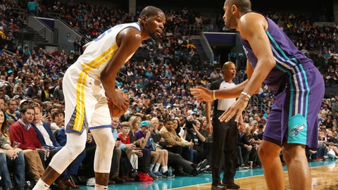 CHARLOTTE, NC - DECEMBER 6:  Kevin Durant #35 of the Golden State Warriors handles the ball against the Charlotte Hornets on December 6, 2017 at Spectrum Center in Charlotte, North Carolina. NOTE TO USER: User expressly acknowledges and agrees that, by downloading and or using this photograph, User is consenting to the terms and conditions of the Getty Images License Agreement.  Mandatory Copyright Notice:  Copyright 2017 NBAE (Photo by Brock Williams-Smith/NBAE via Getty Images)