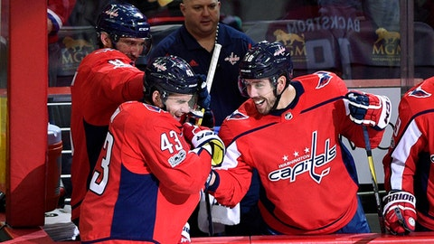 Washington Capitals right wing Tom Wilson (43) celebrates his empty net goal with left wing Alex Ovechkin (8), of Russia, and center Chandler Stephenson (18) during the third period of an NHL hockey game against the Chicago Blackhawks, Wednesday, Dec. 6, 2017, in Washington. The Capitals won 6-2. (AP Photo/Nick Wass)