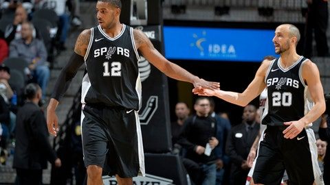 SAN ANTONIO, TX - DECEMBER 6:  LaMarcus Aldridge #12 and Manu Ginobili #20 of the San Antonio Spurs high five during the game against the Miami Heat on December 6, 2017 at the AT&T Center in San Antonio, Texas. NOTE TO USER: User expressly acknowledges and agrees that, by downloading and or using this photograph, user is consenting to the terms and conditions of the Getty Images License Agreement. Mandatory Copyright Notice: Copyright 2017 NBAE (Photos by Mark Sobhani/NBAE via Getty Images)