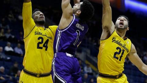 Central Arkansas guard Jordan Howard, center, shoots between California's Marcus Lee (24) and Nick Hamilton (21) during the second half of an NCAA college basketball game Wednesday, Dec. 6, 2017, in Berkeley, Calif. (AP Photo/Ben Margot)