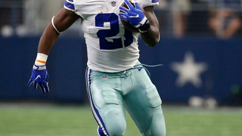 FILE - In this Oct. 1, 2017, file photo, Dallas Cowboys running back Ezekiel Elliott (21) carries the ball for extra yardage after catching a pass in the first half of an NFL football game against the Los Angeles Rams, in Arlington, Texas. Anyone can see just how much the Cowboys desperately miss Elliott. (AP Photo/Ron Jenkins)