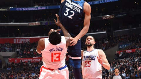 LOS ANGELES, CA - DECEMBER 6: Karl-Anthony Towns #32 of the Minnesota Timberwolves goes up for a dunk against the LA Clippers on December 6, 2017 at STAPLES Center in Los Angeles, California. NOTE TO USER: User expressly acknowledges and agrees that, by downloading and/or using this Photograph, user is consenting to the terms and conditions of the Getty Images License Agreement. Mandatory Copyright Notice: Copyright 2017 NBAE (Photo by Andrew D. Bernstein/NBAE via Getty Images)