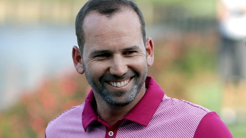 FILE - In this Thursday,, May 11, 2017 file photo, Sergio Garcia, of Spain, smiles as he walks to the 17th green after hitting a home-in-one during the first round of The Players Championship golf tournament in Ponte Vedra Beach, Fla. Garcia has been voted as the European Tour's golfer of the year after claiming his first major title at the Masters and winning two more events in 2017. (AP Photo/Chris O'Meara, File)