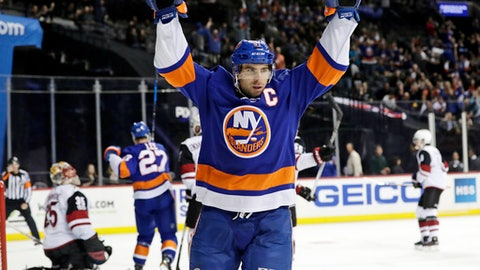 FILE - In this Oct. 24, 2017, file photo, New York Islanders' John Tavares (91) celebrates after scoring a goal against Arizona Coyotes goalie Louis Domingue (35) during the second period of an NHL hockey game in New York. Through the first two months of the season, goals are up more than 12 percent from the same time a year ago, including a 14 percent increase on the power play and a 38 percent spike short-handed. (AP Photo/Frank Franklin II, File)