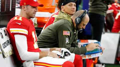 FILE - In this Nov. 5, 2017, file photo ,Kansas City Chiefs' Alex Smith, left, offensive coordinator Matt Nagy, center and quarterback Patrick Mahomes, rear, sit on the bench during an NFL football game against the Dallas Cowboys in Arlington, Texas. Chiefs coach Andy Reid turned over some of the playcalling duties to offensive coordinator Matt Nagy last week, and the immediate returns were good. But that wasn't enough for Reid to guarantee Nagy another shot this weekend.  (AP Photo/Michael Ainsworth, File)