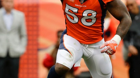 FILE - In this Oct. 1, 2017, file photo, Denver Broncos outside linebacker Von Miller, left, celebrates after sacking Oakland Raiders quarterback EJ Manuel during the second half of an NFL football game, in Denver. Overshadowed by a dismal year, Broncos pass-rush specialist Von Miller has steadily put together another stellar performance. He's a sack away from becoming the first in franchise history to record six 10-sack seasons. (AP Photo/Jack Dempsey, File)