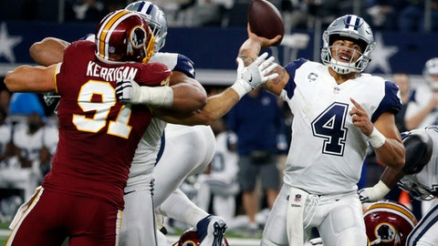 FILE - In this Nov. 30, 2017, file photo, Washington Redskins linebacker Ryan Kerrigan (91) pressures Dallas Cowboys quarterback Dak Prescott (4) as Prescott throws a pass in the second half of an NFL football game, Thursday, in Arlington, Texas. The Cowboys face the New York Giants on Sunday in East Rutherford, N.J. (AP Photo/Michael Ainsworth, FIle)