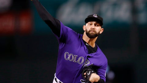 Colorado Rockies starting pitcher Tyler Chatwood throws to a Miami Marlins batter during the first inning of a baseball game Monday, Sept. 25, 2017, in Denver. (AP Photo/David Zalubowski)