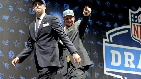 FILE - In this April 28, 2016, file photo, Los Angeles Rams' Jared Goff, left, and Philadelphia Eagles' Carson Wentz, greet fans at Selection Square in Grant Park after the quarterbacks were selected No. 1 and No. 2, respectively, in the NFL football draft in Chicago. The coolest of matchups this weekend has Goff and Wentz facing each other on Sunday. Both have matured rapidly, sparking turnarounds that could lead to, well, the Super Bowl. (AP Photo/Matt Marton, File)