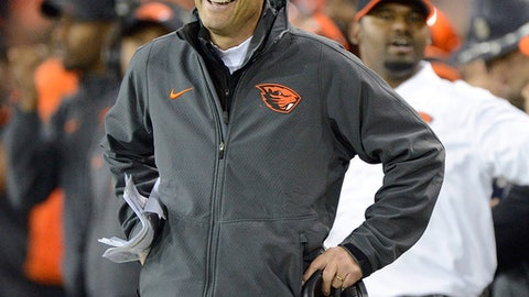 FILE - In this Oct. 16, 2014, file photo, then-Oregon State University NCAA college football head coach Mike Riley smiles at an official during a game against Utah, in Corvallis, Ore. Mike Riley is returning to Oregon State. The former Beavers coach was named an assistant on new coach Jonathan Smith's staff on Thursday, Dec. 7, 2017. Riley, most recently head coach at Nebraska, was coach at Oregon State twice, from 1997-98 and 2003-14. (AP Photo/Troy Wayrynen, File)