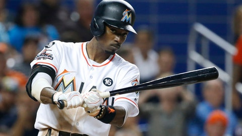 Miami Marlins' Dee Gordon practices his swing before batting during the third inning of a baseball game against the Atlanta Braves, Thursday, Sept. 28, 2017, in Miami. (AP Photo/Wilfredo Lee)