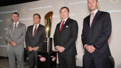 The coaches of the four teams in the College Football Playoff, Lincoln Riley, right, of Oklahoma; Kirby Smart, second from right, of Georgia; Nick Saban, of Alabama; and Dabo Swinney, left, of Clemson, pose together before the College Football Awards show at the College Football Hall of Fame, Thursday, Dec. 7, 2017, in Atlanta. (AP Photo/John Amis)