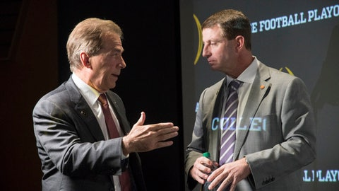 Alabama coach Nick Saban, left, and Clemson coach Dabo Swinney talk after a news conference before the College Football Awards show at the College Football Hall of Fame, Thursday, Dec. 7, 2017, in Atlanta. Clemson and Alabama will face each other in a College Football Playoff semifinal. (AP Photo/John Amis)