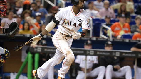 FILE - In this Sept. 30, 2017, file photo, Miami Marlins' Dee Gordon hits a single during the fifth inning of a baseball game against the Atlanta Braves in Miami. Gordon has been traded to the Seattle Mariners for three prospects in a deal that marks the start of the Marlins' latest payroll purge, this time under new CEO Derek Jeter. (AP Photo/Lynne Sladky, File)